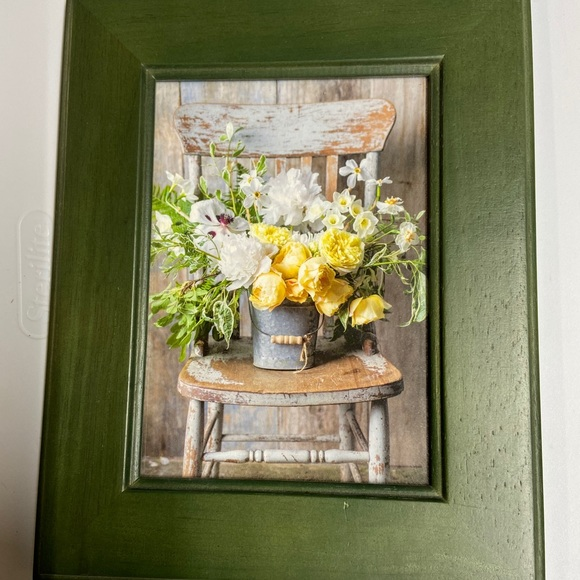 Medium green wood frame with old chair photo.